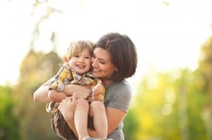 mom holding child | Melissa Graham-Hurd & Associates