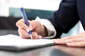 lady holding pen to paper | Melissa Graham-Hurd & Associates