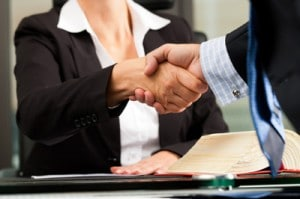 lawyer and client shaking hands | Melissa Graham-Hurd & Associates