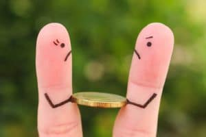 Fingers Drawn as Husband and Wife Fighting Over Coin: Divide Finances During Divorce