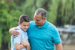 Divorced Dad with Arm Around Son's Shoulders | Melissa Graham-Hurd & Associates