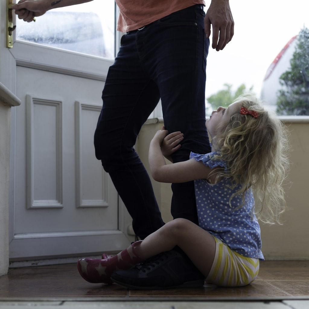 Child Crying at Parenting Time Transition - Holding Onto Dad's Leg