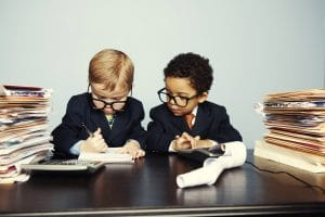 2 Little Boys with Calculators | Melissa Graham-Hurd & Associates
